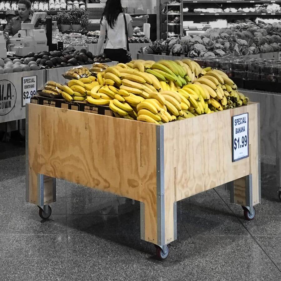 Orchid Bin with bananas in supermarket fruit and veg deparment